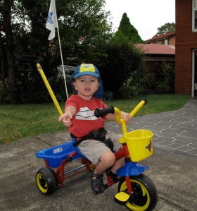 Lenny riding his new trike